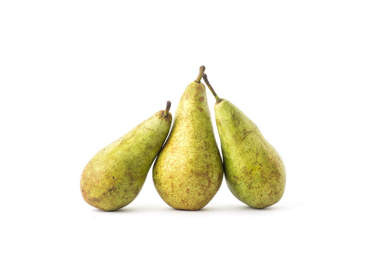 Three Pear lying against each other. Isolated on a white background Close-up Crunchy Delicious Fruits Food Food And Drink Fresh Fruit Freshness Fruit Fruits In The Kitchen Green Color Green Color Healthy Eating Healthy Food Healthy Snack Lunch Box No People One A Day Keep I Doctor Away Pear Pears Pink Lady Studio Shot Sweet And Juicy Sweet Food Three Pears White Background