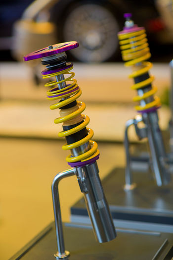 Yellow shock up for car. Industrial Industry Absorber Business Car Close-up Color Image Detail Details Focus On Foreground In A Row Indoors  Large Group Of Objects Metal No People Selective Focus Shock Absorber Table Technology Yellow