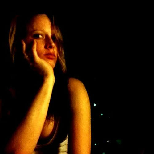 Beauty One Young Woman Only Illuminated One Woman Only Indoors  Black Background Dark Night Close-up Looking At Camera Independent Woman Real People Tranquility Long Hair Seductive Curves Portrait