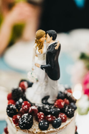 Close-up of couple on top of dessert