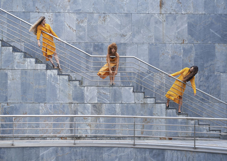 High angle view of women on steps against wall