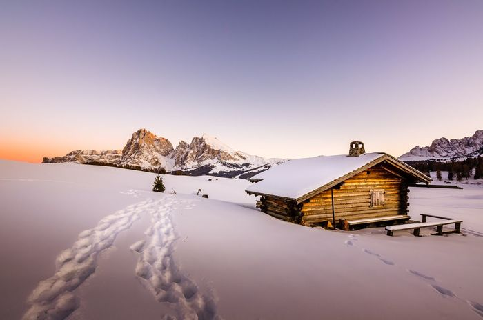 Step by step. Clear Sky Mountain Range Architecture Built Structure Snowcapped Mountain No People Frozen Landscape Outdoors Weather House Tranquility Nature Tranquil Scene Beauty In Nature Scenics Mountain Cold Temperature Winter Snow South Tyrol Alto Adige Südtirol Dolomiti Dolomites Dolomites Italy Alpe Di Siusi