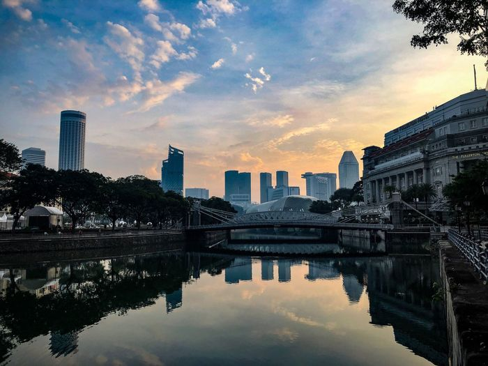 Singapore River at dawn Fullerton Hotel Singapore River Singapore Building Exterior Built Structure Architecture City Water Sky Reflection Urban Skyline Landscape No People Cityscape