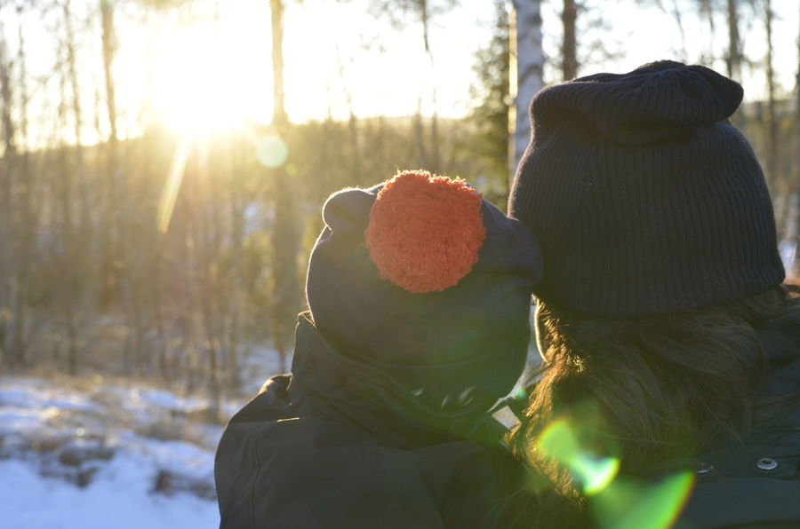 Enjoying the sunset with mom. Alone Carefree Childhood Close-up Enjoying The View Family Flower Focus On Foreground Fragility Freshness Fun Growth Holding Innocence Kidsphotography Light One Person Parenthood Petal Plant Red Selective Focus Winter Things I Like