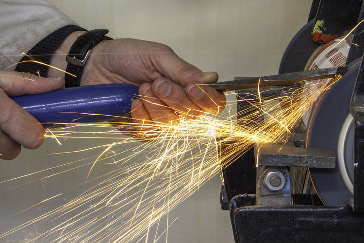 Grindin Hands Blurred Motion Chisel Equipment Factory Finger Grinding Wheel Holding Human Hand Industrial Equipment Industry Long Exposure Machinery Manufacturing Equipment Metal Metal Industry Occupation Real People Sharpening Skill  Sparks Working