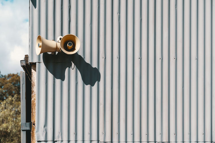 Low angle view of megaphone on wall outdoors