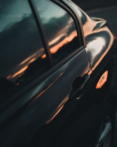 Close-up of sunglasses on car