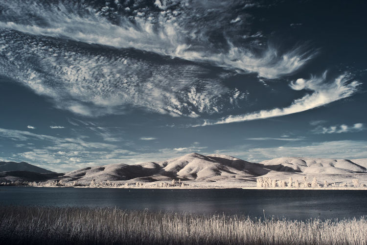 Infrared Landscape Infrared Interesting Unusual Beauty In Nature Cloud - Sky Clouds And Sky Contrast Day Environment Idyllic Infrared Photography Lake Mountain Mountain Range Nature No People Non-urban Scene Reed Scenics - Nature Sky Surreal Tranquil Scene Tranquility Water Waterfront