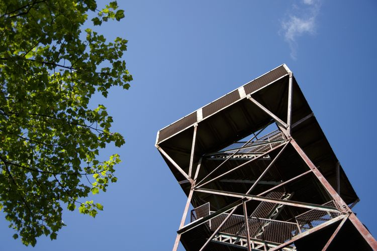 Low angle view of tower against blue sky