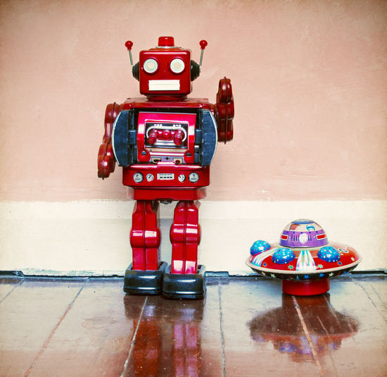 red robot next to his UFO Fun Ray Gun Reflection Retro SiFi UFO Childhood Colorful Creativity Flooring Futuristic Hi Human Representation Indoors  Play Red Retro Styled Robot Robot Toys Tin Toys Toy Vintage Toys