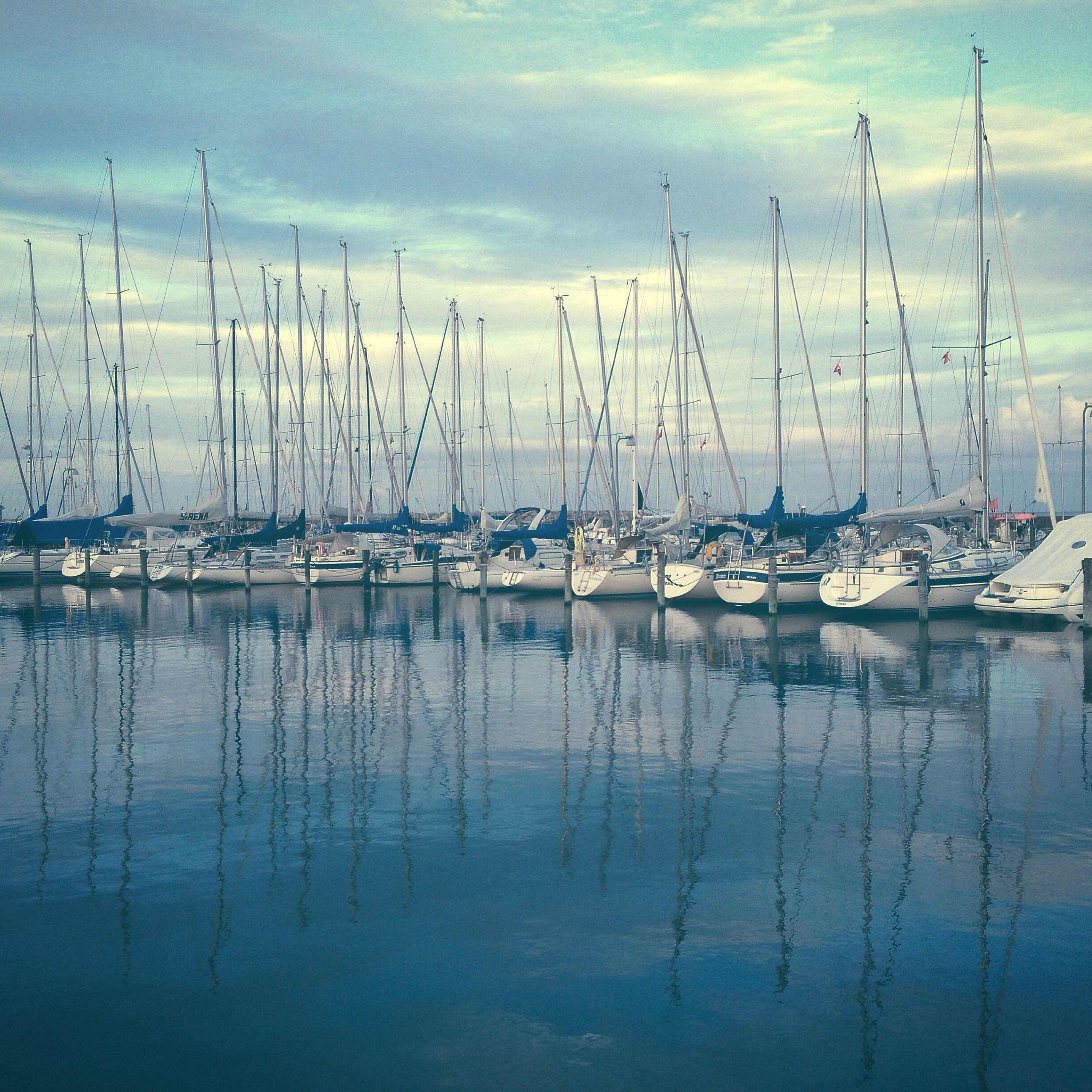 water, nautical vessel, reflection, sky, moored, boat, lake, tranquility, transportation, waterfront, tranquil scene, nature, cloud - sky, mast, cloud, sailboat, sea, scenics, mode of transport, beauty in nature