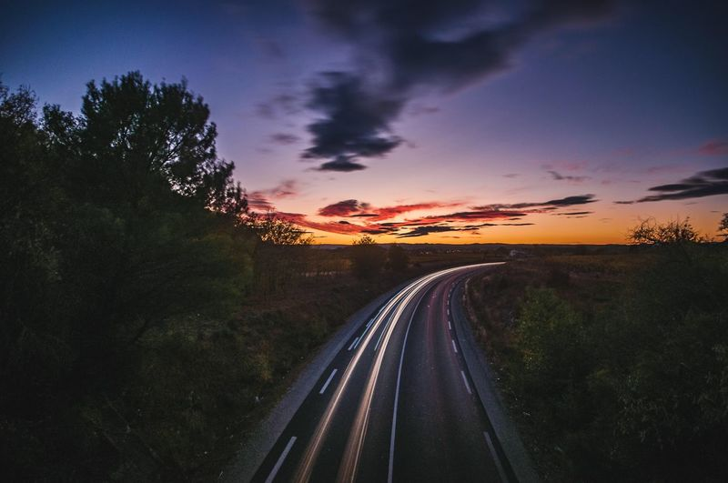 Speed time Longexposure Transportation Sky Sunset Road Tree Cloud - Sky Nature The Way Forward Direction Mode Of Transportation No People Car Motor Vehicle Motion Outdoors Beauty In Nature