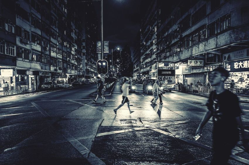Monochrome Street Photography Reframinghk Discoverhongkong Nightshooters Building Exterior City Architecture Built Structure Street Transportation Night Real People Road Mode Of Transportation Car Nature Illuminated Motor Vehicle City Life Men Building Walking Wet Lifestyles