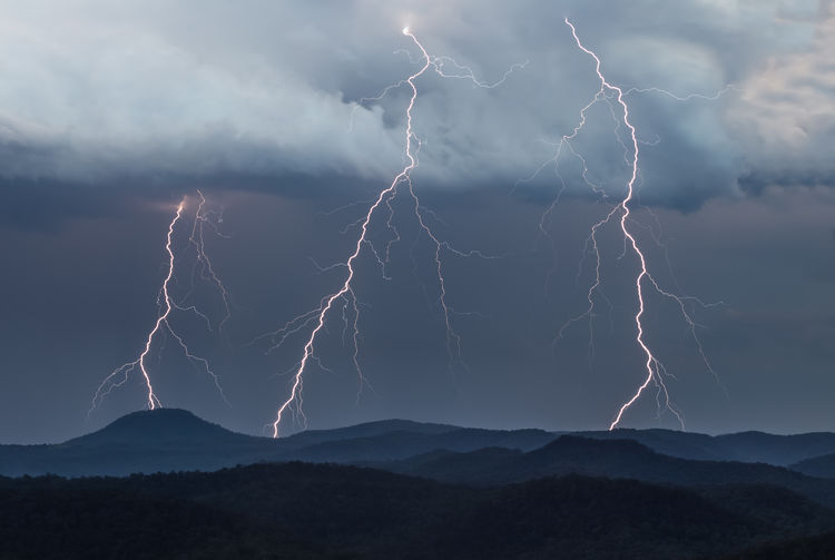 The storm season is well and truly underway at Wombanook! This shot was taken at dusk last night from our ridgetop property at Laguna looking over the Wollombi valley towards the Watagan mountains. The highest point is Mount Warrawolong at 641 metres (2,103 ft) above sea level, which is taking a direct hit of lightning in this shot. The severe storm season sees an increase in storms due to the increase in energy provided by the sun during the warmer summer months, coupled with weather patterns that are favorable for storm growth. The Watagan Mountains, or Watagans, is a mountain wilderness area that forms part of the Great Dividing Range, located in the Hunter region of New South Wales, Australia. Love Life, Love Photography Australia Cloud Clouds Dark Direct Hills Hunter Laguna Layers Light Lightning Mountain Mountains New Night Nsw Ominous Rain Season  Sky South Storm Strike Trees Wales Perspectives On Nature