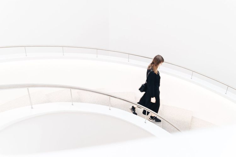 One Person Full Length Rear View Adults Only One Woman Only Only Women (null)Women Steps And Staircases Staircase Young Adult Indoors  Architectural Feature Architecture_collection Minimalist Architecture Minimalobsession Minimalism Minimal Light Modern