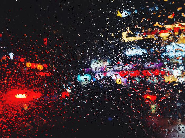 Full frame shot of wet glass window at night