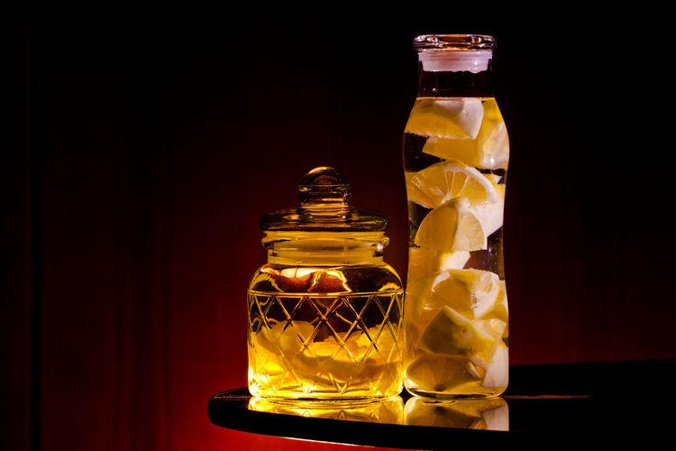 Infusion of lemon peel and lemon (no peel) in Vodka. Liquor Black Background Bottle Close-up Drink Flavor Indoors  Jar Lemon Lid No People Studio Shot Vodka
