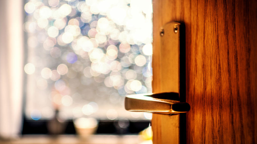 Close-up of door against lens flare