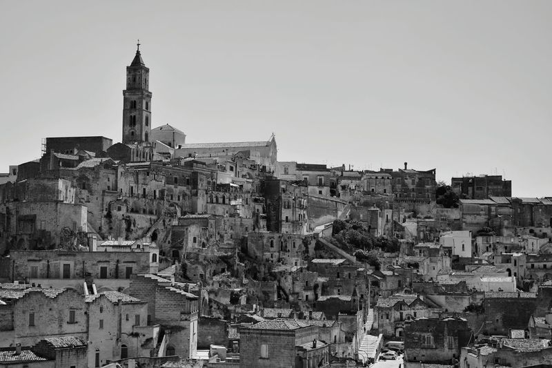 Matera Sassidimatera, Basilicata, Italy, Rainbow, Stones, PatrimoniomondialeUNESCO, Cityscape Architecture Tower Skyscraper Building Exterior Downtown District City Urban Skyline No People Outdoors Sky Day Streetphotography Arts Culture And Entertainment Architecture Cultures Travel Destinations Young Adult Fashion Tradition Sitting Italy City