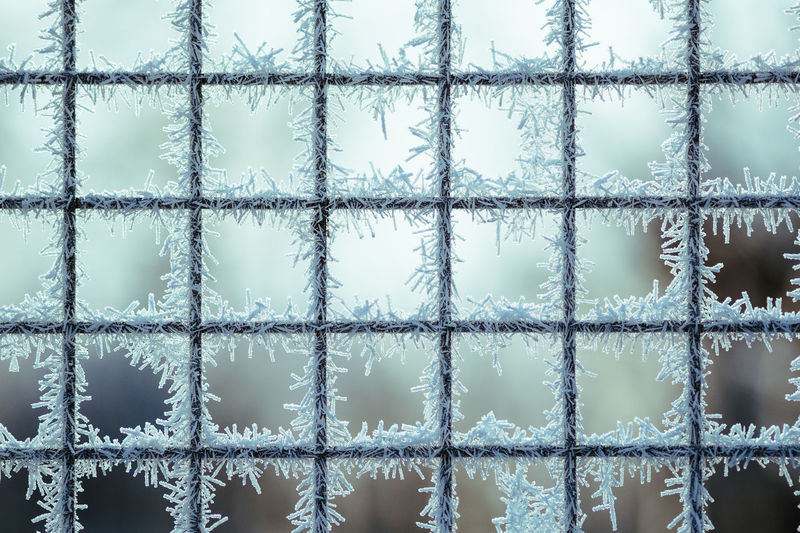 Full Frame Shot Of Snowflakes On Widow