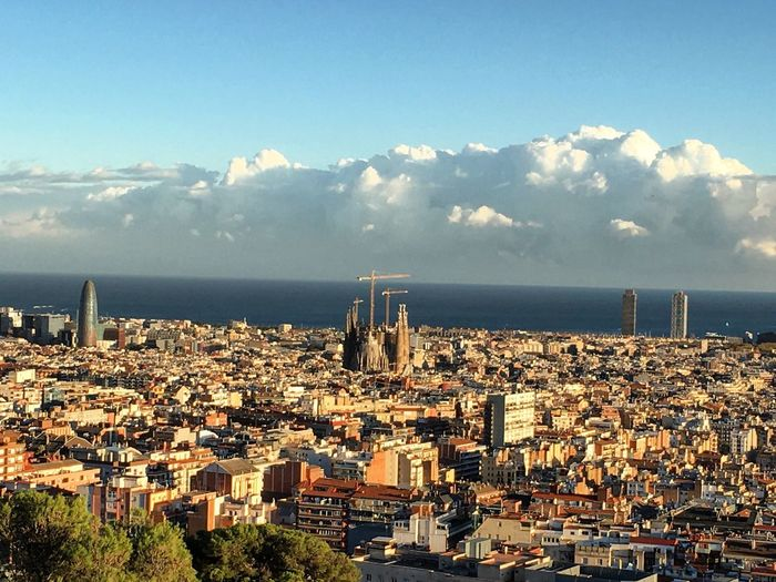 Barcelona in all its splendor! Gaudi's Sagrada Familia (170m) in the middle (still being build) and to the left of it the Torre Agbar (144m) by Jean Nouvel. While to the right isTorre Mapfre (154m) in the Port Olímpic, the maritime neighborhood of the Old City. Cityscapes City City View  Enjoying The View Urban Landscape Urban Architecture Skyscrapers Cloudporn Check This Out The Adventure Handbook