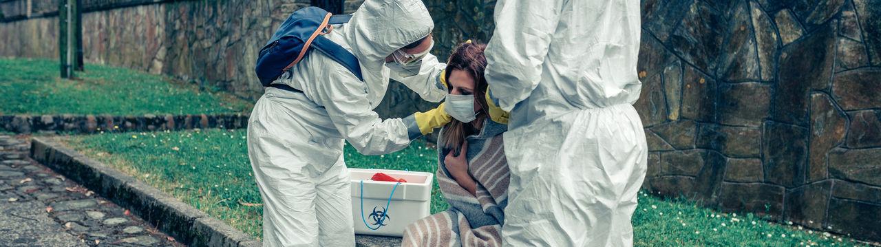 Doctors examining woman outdoors