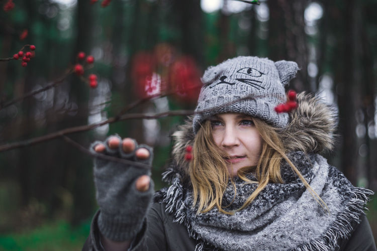 Cold Temperature Winter Warm Clothing Adult People One Person Front View Outdoors Young Adult Knit Hat Portrait Day Adults Only One Woman Only Tree Smiling Emotions Red Girl In Forest Women Happiness Nature