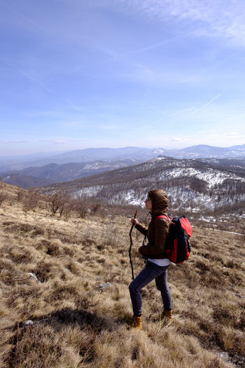Hiking on the mountain Rtanj, Serbia Adult Adventure Backpack Beauty In Nature Day Full Length Hiking Landscape Leisure Activity Mountain Mountain Range Nature One Person One Woman Only Outdoors Sky Snow Warm Clothing Winter Young Adult