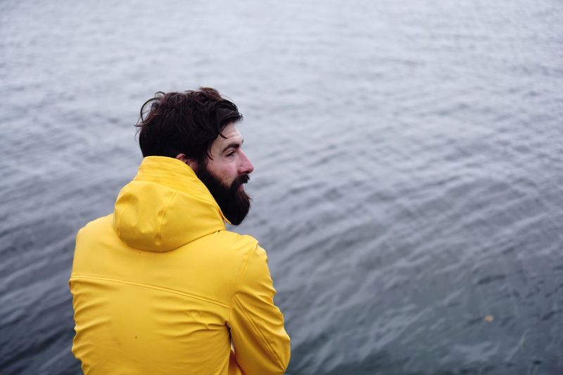 EyeEm Selects Water One Person Real People Yellow Casual Clothing Day Leisure Activity Outdoors Lifestyles Rear View Beard Sea Nature Men The Week On EyeEm Real Photography Nature In The City Seascape Sealife Portrait Portrait Photography Mensfashion Portrait Of A Man  Young Adult The Portraitist - 2018 EyeEm Awards The Traveler - 2018 EyeEm Awards