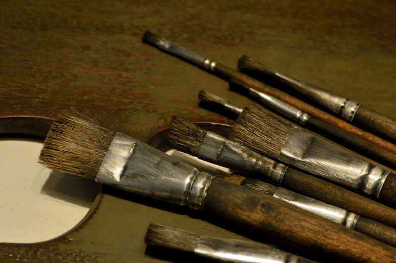 Close-up of paintbrushes on table