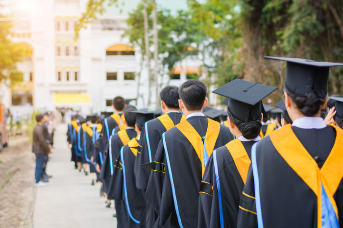 Achievement Celebration Ceremony Education Graduation Graduation Gown In A Row Large Group Of People Outdoors People Rear View Standing Student Togetherness Tree Uniform University Student