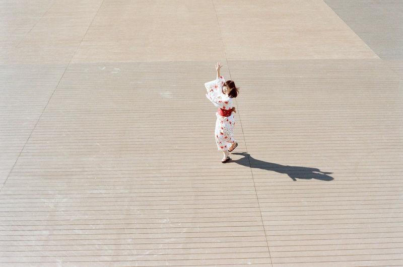 High angle view of girl dancing on hardwood floor