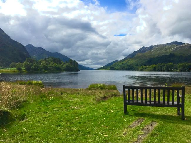 Breathtaking Quiet Moments Scotland Scottish Highlands Clouds And Sky Beautiful Sunshine Idyllic Scenery Relaxing Bench Lakeview Water Sky Mountain Cloud - Sky Beauty In Nature Tranquility Lake Nature Plant No People Scenics - Nature Green Color Tranquil Scene Grass Day Mountain Range Idyllic Growth Outdoors