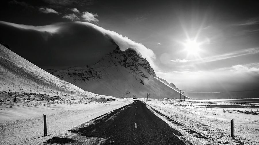 Road passing through snow covered mountains
