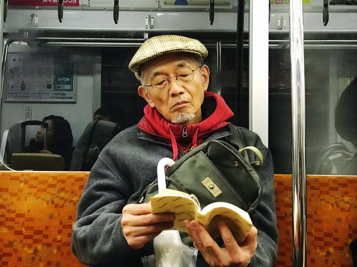 Notes From The Underground Reading A Book Reading Analog Lifestyle Analog Train - Vehicle One Person Real People Public Transportation Subway Train