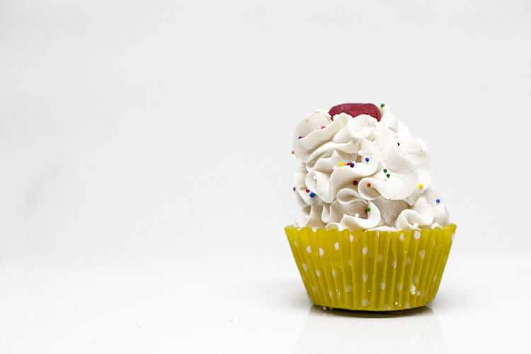 Sweet Food Sweet Dessert Indulgence Food And Drink Food White Background Cake Copy Space Temptation Unhealthy Eating Studio Shot Indoors  Still Life Cream Freshness Cupcake Sprinkles Baked Whipped Cream No People Icing Garnish