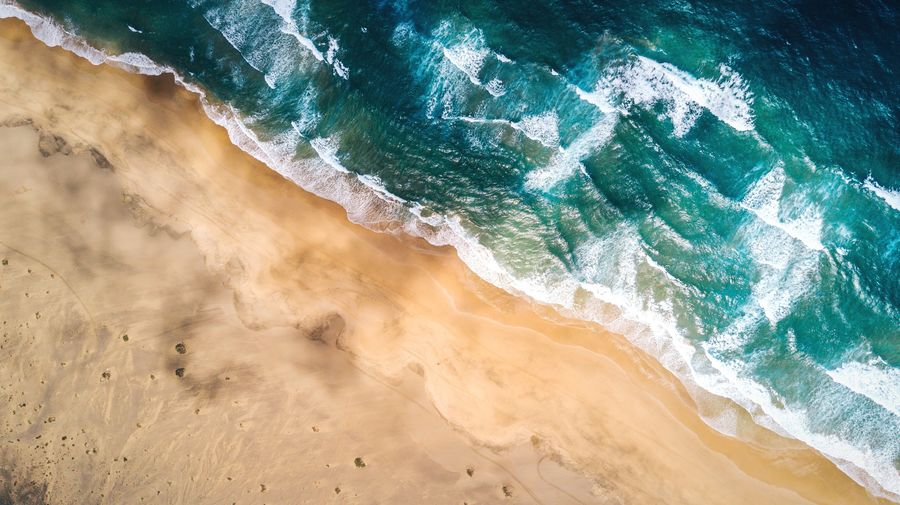 Yellow vs Blue Wave Beach Sea Sand Live For The Story Nature Power In Nature Summer Tide Perspectives On Nature Beauty In Nature Water No People Outdoors Scenics Color Contrast Dronephotography Drone  BYOPaper! DJI Mavic Pro The Great Outdoors - 2017 EyeEm Awards Landscape Waves Coastline Lost In The Landscape