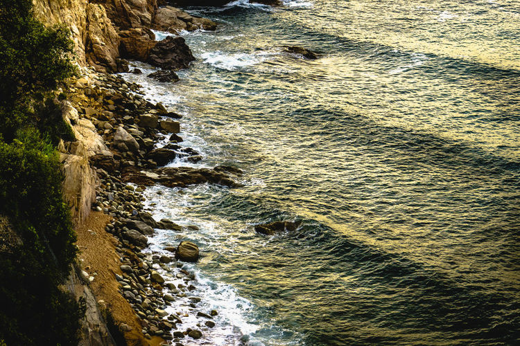 Water Motion Beauty In Nature High Angle View Sea Rock Nature Day Sport Outdoors Scenics - Nature Land Aquatic Sport Flowing Water Flowing Power In Nature Sunlight No People Rock - Object Solid Tranquil Scene Rock Formation