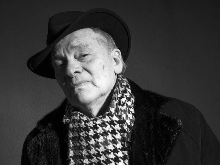 Close-up portrait of man wearing hat