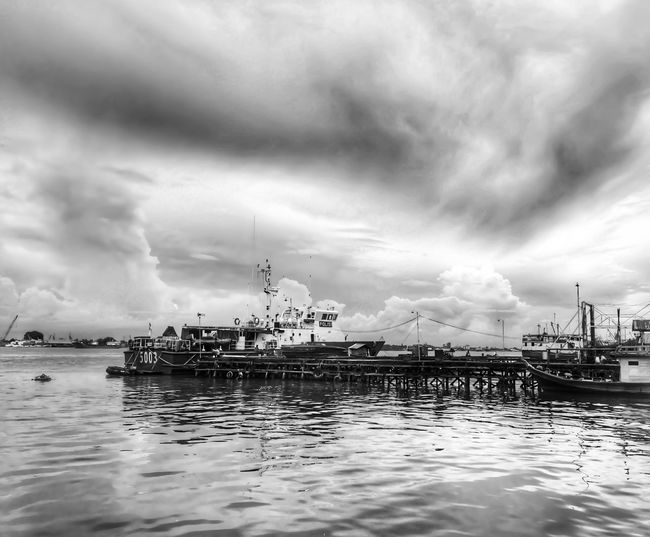 Two Colors of Nature Blackandwhite Cloud - Sky Nautical Vessel Sky Water Transportation Mode Of Transport Harbor Nature Outdoors Tranquility Beauty In Nature Moored No People Scenics Day Yacht Mast Horizon Over Water