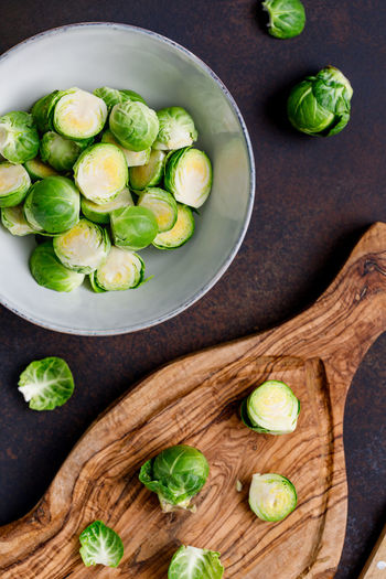 Healthy Eating Food And Drink Vegetable Food Freshness Wellbeing Brussels Sprout Directly Above Table Indoors  No People Bowl Green Color Still Life Wood - Material Ingredient High Angle View Close-up SLICE Cutting Board Vegetarian Food
