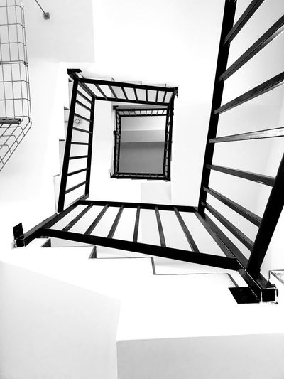 Low angle view of spiral staircase of building
