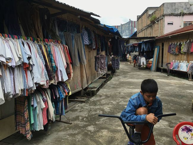 Used Clothing Store Men Child Boys Childhood Architecture Street City Real People Building Exterior Casual Clothing People Day Lifestyles Leisure Activity Standing Innocence Outdoors Built Structure Incidental People Males  EyeEmNewHere Urban Fashion Jungle #urbanana: The Urban Playground