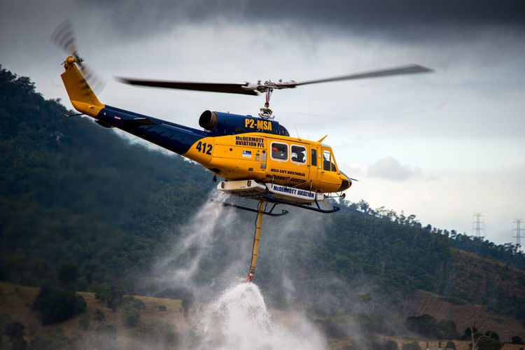 Bell 214B displaying her fire fighting abilities during Red Thunder Airshow 2018 at Watts Bridge, Queensland Australia Airshow Rotor Air Vehicle Airplane Aviation Aviationphotography Day Fire Fighter Fire Fighting Flight Flying Helicopter Mid-air Mode Of Transportation Motion Nature No People Outdoors Pilot Transportation Water Bomber