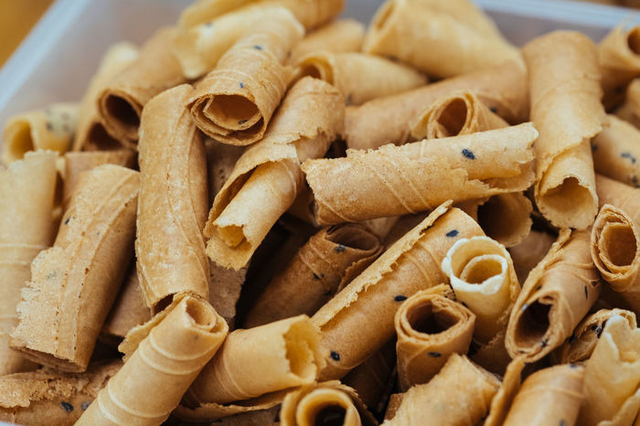 Thong Muan Dessert Tong Muan Close-up Day Food Food And Drink Freshness Indoors  No People Ready-to-eat Stick Thaifood Wafer Rolls