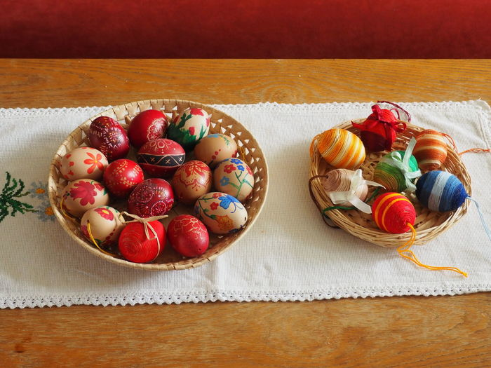 High Angle View Of Decorative Easter Eggs In Baskets On Table