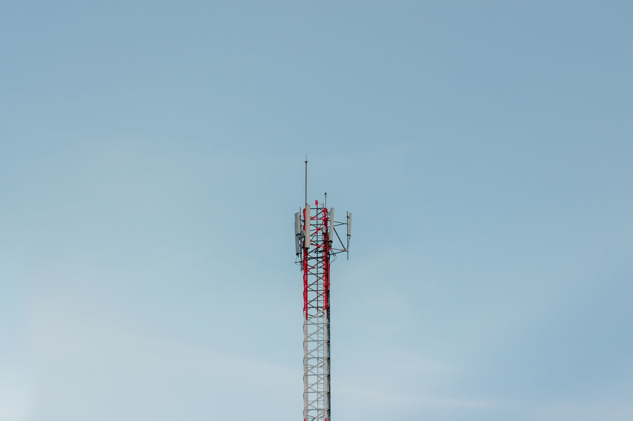 sky, communication, low angle view, technology, tower, antenna - aerial, broadcasting, copy space, architecture, tall - high, no people, built structure, day, clear sky, blue, connection, global communications, nature, wireless technology, outdoors