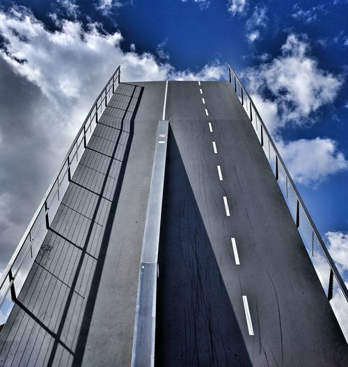 Low angle view of bascule bridge against sky