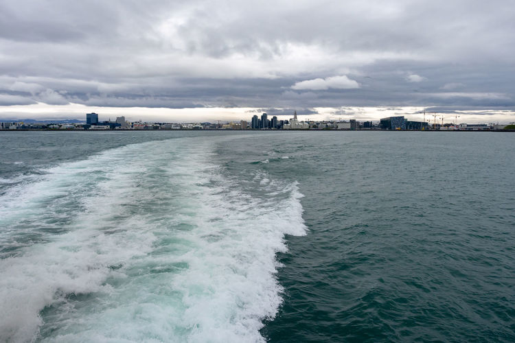 City Water Sea Outdoors Motion Iceland Reykjavik Whale Watching Trip Boat Leaving Ocean Atlantic Ocean Travel Travel Destinations Rippled Waterfront No People Coastline TOWNSCAPE