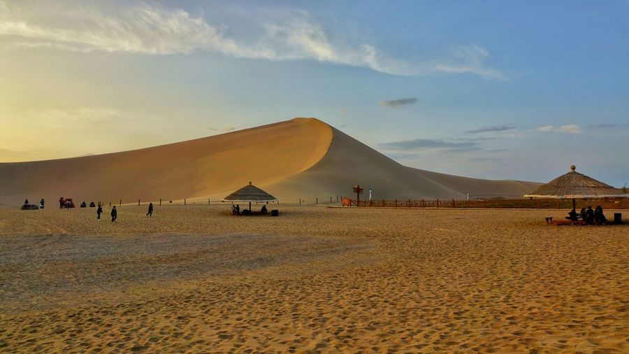 Sand Dune Gobi Desert Landscape Sky Outdoors Large Group Of People Nature Hot Nature Background Scenics Ancient Travel Destinations Tourism People Sand DunHuang China View China,Guizhou Beauty In Nature Landmark landscape Nature photography Landscapes Hugh Sand Dune EyeEm Selects Roof In The Desert